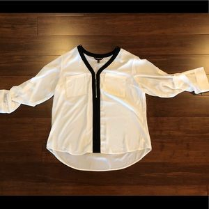 Black and white zip front blouse